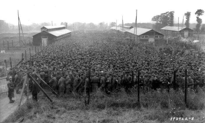 German prisoners of war captured after the D-Day landings in Normandy are guarded by U.S. troops at a camp in Nonant-le-Pin, France, on Aug. 21, 1944. (Photo: U.S. National Archives/handout via Reuters)