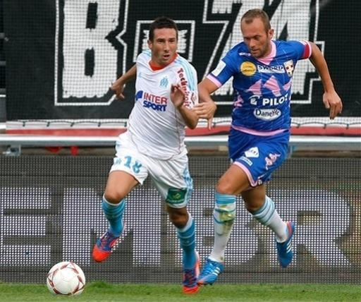 Marseille's French midfielder Morgan Amalfitano, left, challenges for the ball with Evian's French midfielder Olivier Sorlin, during their League One soccer match, at the Velodrome stadium, in Marseille, southern France, Sunday, Sept. 23, 2012. (AP Photo/Claude Paris)