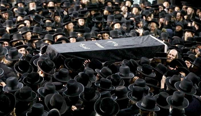 Mourners carry Moshe Deutsch's casket outside a synagogue following his funeral in 2019 in New York. Deutsch, 24, was killed that December in a shooting at a kosher food market in Jersey City, N.J.