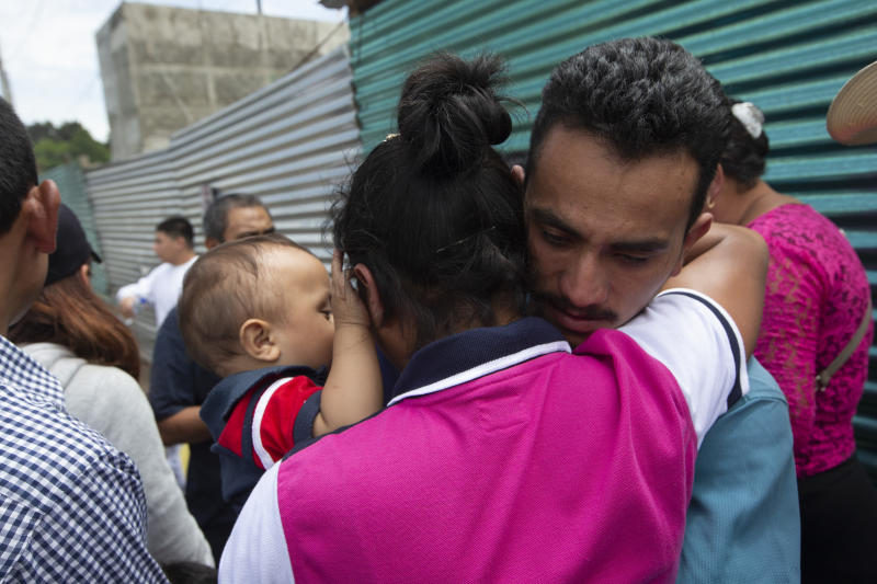 A Guatemalan migrant, who was deported from the United States, embraces relatives after arriving at the Air Force Base in Guatemala City, Tuesday, July 16, 2019. Nearly 200 Guatemalan migrants have been deported on Tuesday, the day the Trump administration planned to launch a drastic policy change designed to end asylum protections for most migrants who travel through another country to reach the United States. (AP Photo/Moises Castillo)