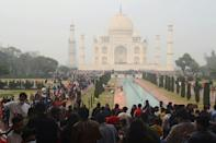 Crowds throng at the Taj Mahal over the weekend as India fights rising coronavirus infections