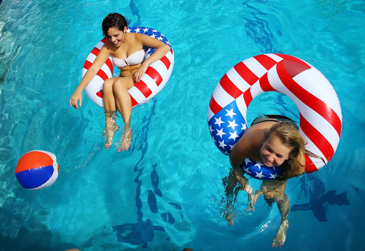 Students Ali Guerra (L) and Carlie Admire play in the campus pool prior to the debate between U.S. President Barack Obama and Republican presidential candidate Mitt Romney at Lynn University on October 22, 2012 in Boca Raton, Florida. The focus for the final presidential debate before Election Day on November 6 is foreign policy.  (Photo by Joe Raedle/Getty Images)
