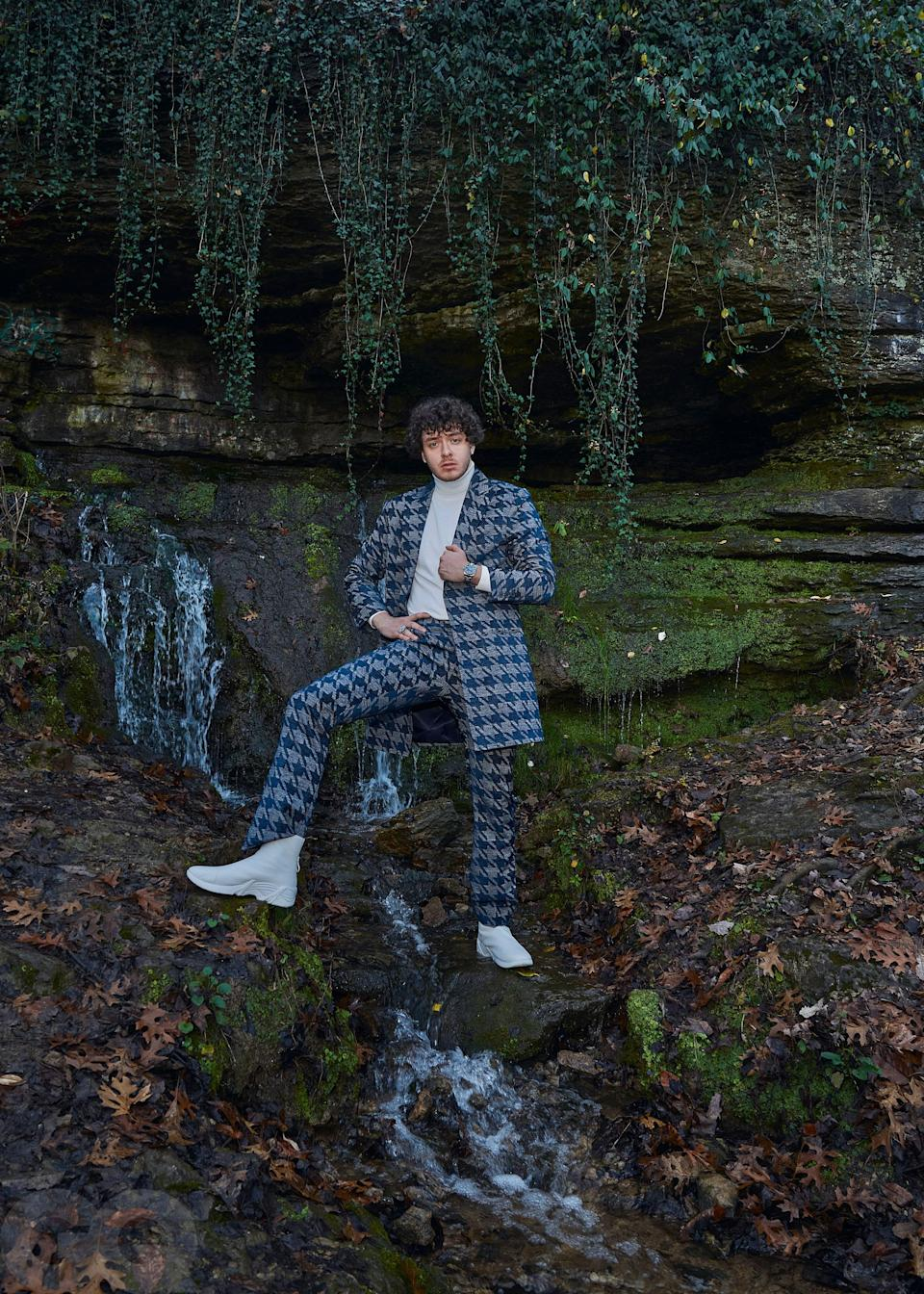 """<cite class=""""credit"""">Suit, $1,850, by Grayscale / Turtleneck, $590, by Thom Browne / Boots, $515, by Raf Simons / Watch (throughout), his own, by Rolex / Ring (throughout), his own</cite>"""