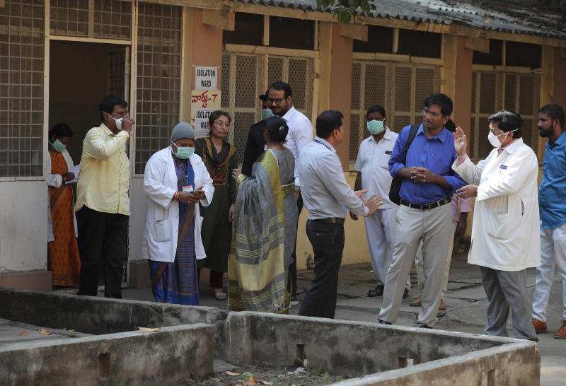 A team of experts from Indian health ministry interact with staff outside of an isolation ward for people who returned from China and under observation at the Government Fever Hospital in Hyderabad, India, Tuesday, Jan. 28, 2020. Countries with citizens in the central Chinese city that's the epicenter of a viral outbreak are planning evacuations as the number of illnesses grow and China takes drastic measures to try to stop the spread of the virus. (AP Photo/Mahesh Kumar A.)