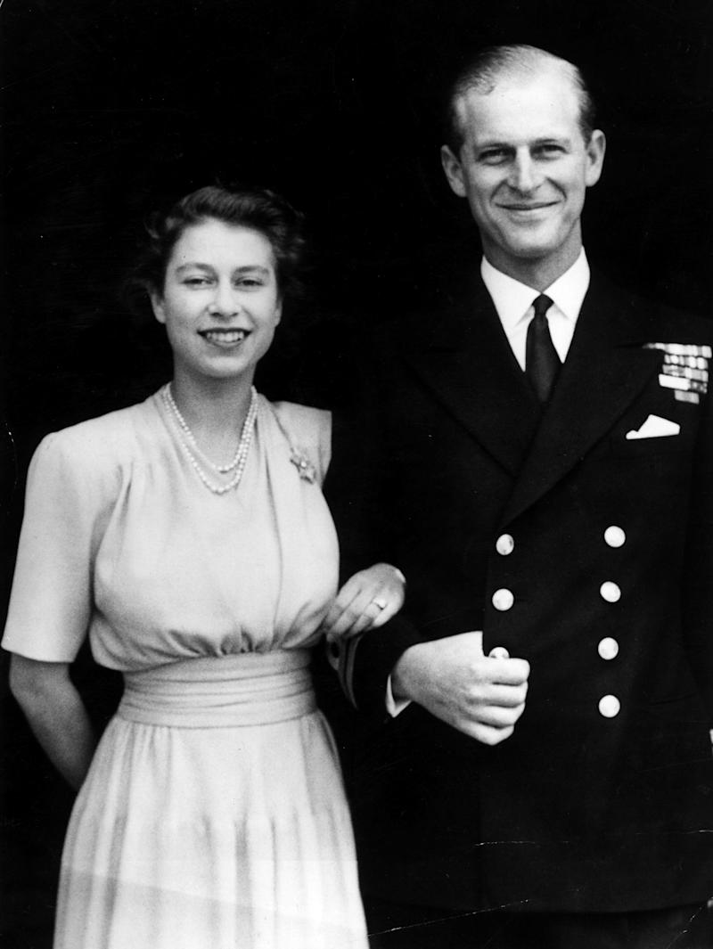 The first official picture after the announcement of the engagement of Princess Elizabeth and Lieutenant Philip Mountbatten, the former Prince Philip of Greece, at Buckingham Palace. Photo by Hulton Archive/Getty Images.