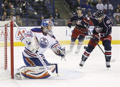 Edmonton Oilers goalie Devon Dubnyk (40) blocks a shot by Columbus Blue Jackets' Nick Foligno (71) in the second period of their NHL hockey game, Tuesday, March, 5, 2013, in Columbus, Ohio. (AP Photo/Mike Munden)