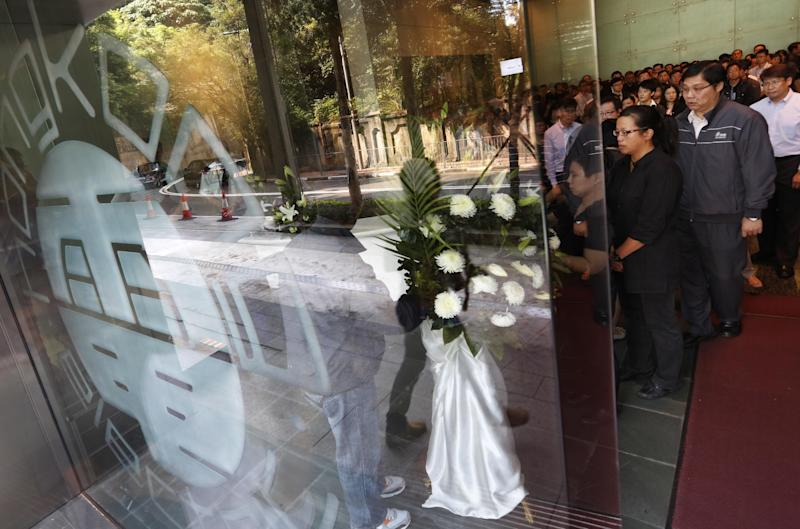 Staff members of The Hong Kong Electric Co. pay tribute to victims who were killed in a ferry collision in Hong Kong Wednesday, Oct. 3, 2012. An official with the company that owns the ferry involved in a collision that killed 38 people said Wednesday that the vessel recently passed inspection, but he had no details about how the crash occurred. Nelson Ng, general manager of Hong Kong and Kowloon (Ferry) Holdings, said the company has not been able to talk to the captain of its ferry, who has been hospitalized since Monday's crash.(AP Photo/Str)