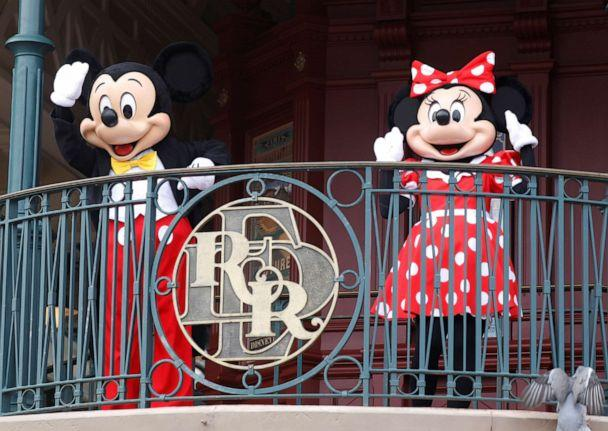 PHOTO: Disney characters Mickey Mouse and Minnie welcome visitors at Disneyland Paris as the theme park reopens its doors to the public in Marne-la-Vallee, in France,  July 15, 2020. (Charles Platiau/Reuters)