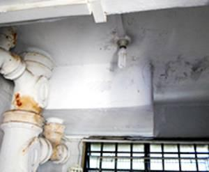 Rusty piping and ceiling cracks in a HDB flat before the Home Improvement
