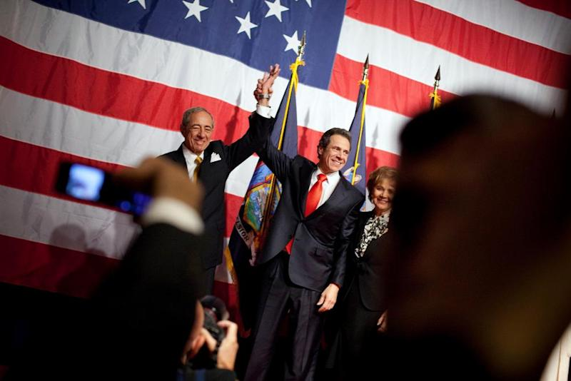 New York Governor-elect Andrew Cuomo (C) celebrates with his father former New York Governor Mario Cuomo (L) and mother Matilda Cuomo at the Sheraton New York on election night, November 2, 2010 in New York City.
