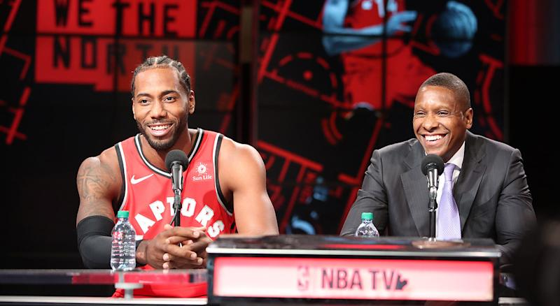 Leonard, left, and Ujiri share a laugh during a press conference. (Steve Russell/Toronto Star via Getty Images)