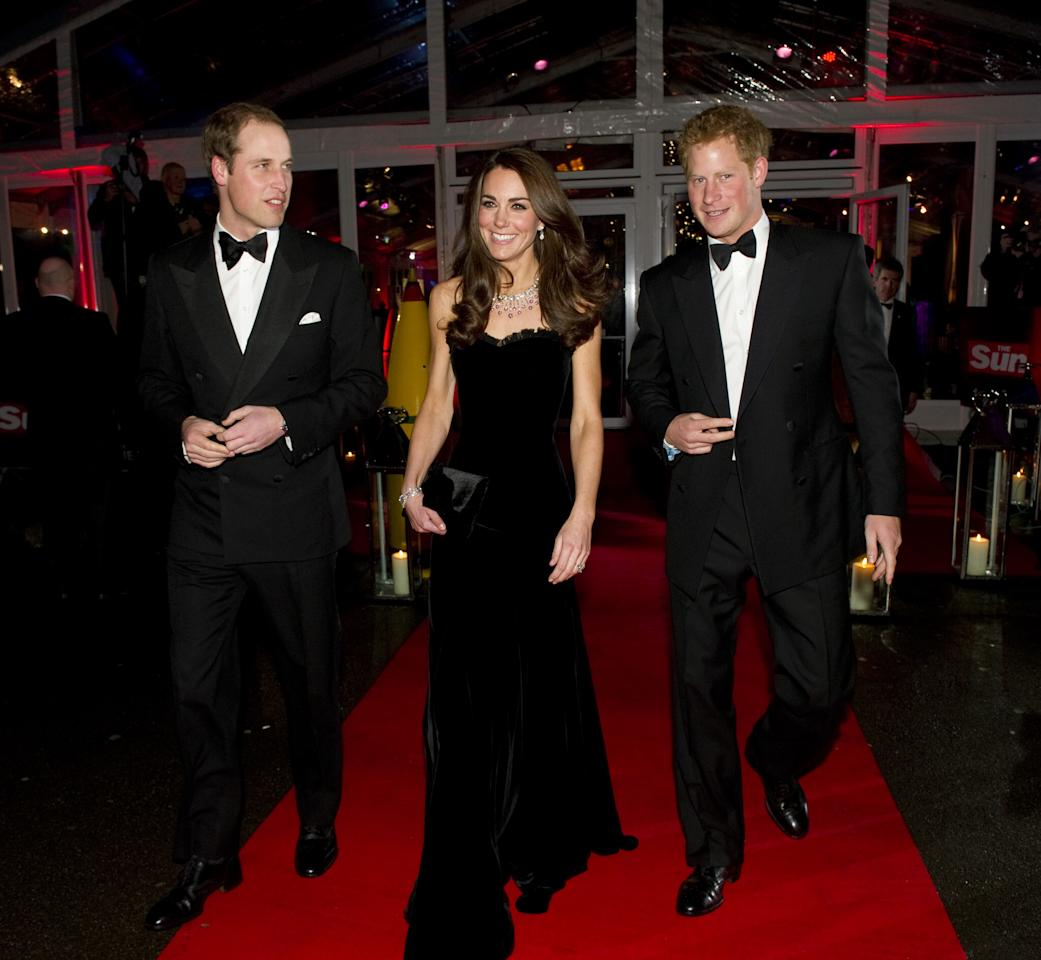 LONDON, ENGLAND - DECEMBER 19: Prince William, Duke of Cambridge, Catherine, Duchess of Cambridge and Prince Harry attend The Sun Military Awards at Imperial War Museum on December 19, 2011 in London, England. (Photo by Arthur Edwards - WPA Pool/Getty Images)