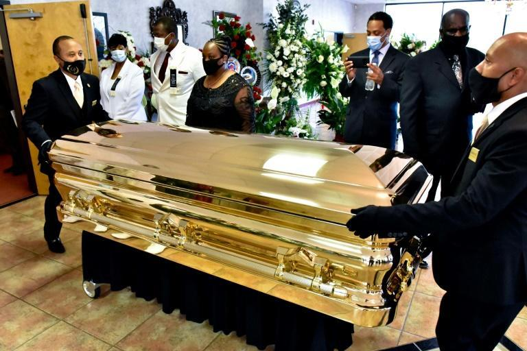 The casket is moved at the conclusion of the memorial service for George Floyd in Raeford, North Carolina, on June 6, 2020