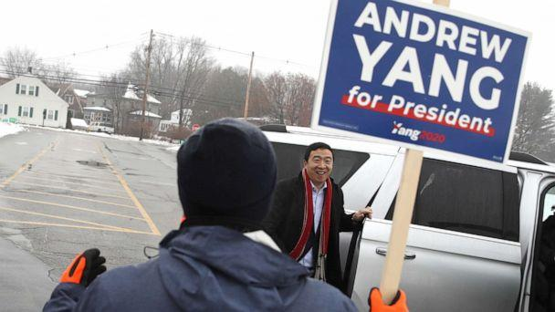 PHOTO: Democratic presidential candidate Andrew Yang greets a supporters who is holding a campaign sign in front of a polling station, Feb. 11, 2020, in Keene, N.H. (Justin Sullivan/Getty Images)