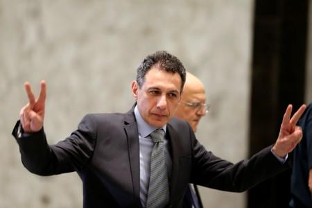 Freed Lebanese businessman Nizar Zakka, who had been detained in Iran since 2015, gestures as he arrives at the presidential palace in Baabda