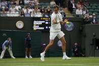 Russia's Daniil Medvedev plays a return to Germany's Jan-Lennard Struff during the men's singles first round match on day two of the Wimbledon Tennis Championships in London, Tuesday June 29, 2021. (AP Photo/Alastair Grant)