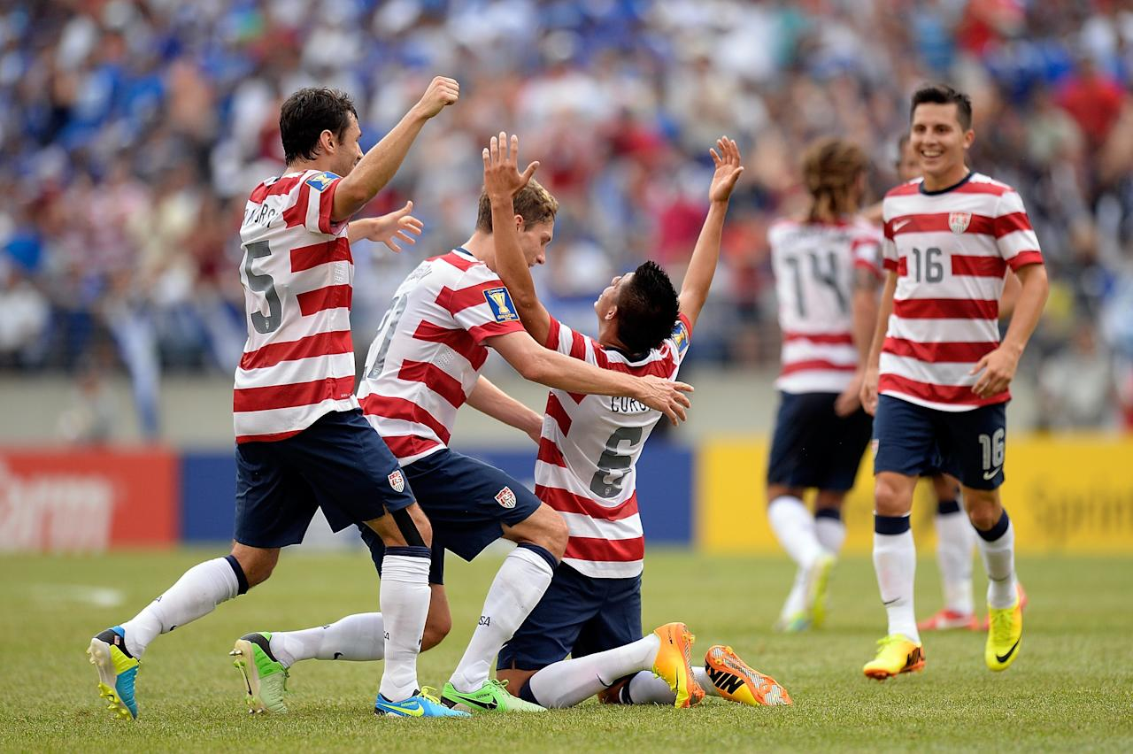 BALTIMORE, MD - JULY 21: Joe Corona #6 of the United States celebrates with his teammates after scoring a goal in the first half against El Salvador during the 2013 CONCACAF Gold Cup quarterfinal game at M&T Bank Stadium on July 21, 2013 in Baltimore, Maryland. (Photo by Patrick McDermott/Getty Images)