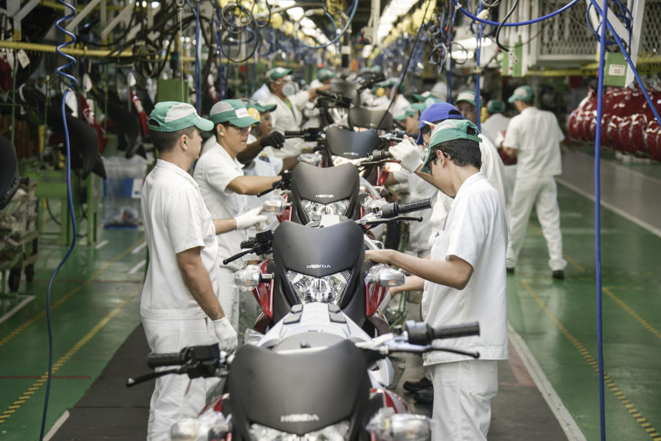 Motorcycles assembly line at Honda Plant, Manaus, Brazil on Wednesday April 9th, 2014 (Photo by Paulo Fridman/Corbis via Getty Images)