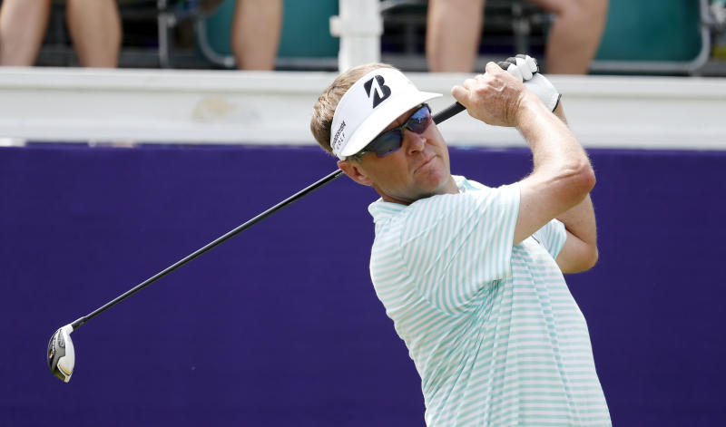 Davis Love III watches his drive on the 10th hole during the first round of the St. Jude Classic golf tournament Thursday, June 6, 2013, in Memphis, Tenn. Love finished the day at 4-under par. (AP Photo/Rogelio V. Solis)