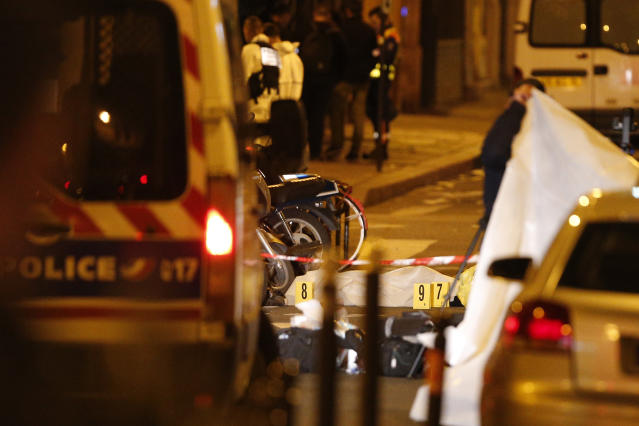 <p>A dead body lays under a blanket after a knife attack Saturday that left at least two dead including the assailant in central Paris, early Sunday May 13, 2018. (Photo:Thibault Camus/AP) </p>