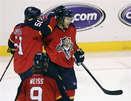 Florida Panthers' Brian Campbell (51) celebrates with Kris Versteeg (32) after Versteeg scored the first goal of the game during the second period of Game 5 in a first-round NHL Stanley Cup playoff hockey series in Sunrise, Fla., Saturday, April 21, 2012, against the New Jersey Devils. (AP Photo/J Pat Carter)