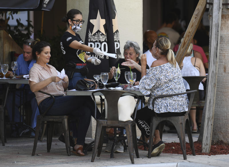 People are seen dining outdoors as Boca Raton restaurants re-open in accordance with Palm Beach County's Phase 1 reopening of businesses during the Coronavirus COVID-19 pandemic on May 11, 2020 in Boca Raton, Florida. Credit: mpi04/MediaPunch /IPX