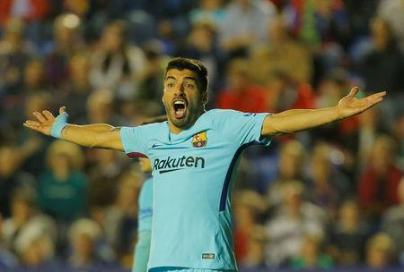FILE PHOTO: Soccer Football - La Liga Santander - Levante vs FC Barcelona - Ciutat de Valencia, Valencia, Spain - May 13, 2018 Barcelona's Luis Suarez reacts REUTERS/Heino Kalis
