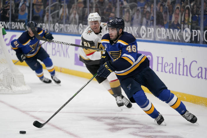 St. Louis Blues' Jake Walman (46) handles the puck as Vegas Golden Knights' Jonathan Marchessault (81) watches during the third period of an NHL hockey game Wednesday, April 7, 2021, in St. Louis. (AP Photo/Jeff Roberson)