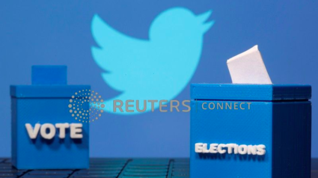 """The Twitter logo appears next to ballot boxes labeled """"vote"""" and """"elections."""""""