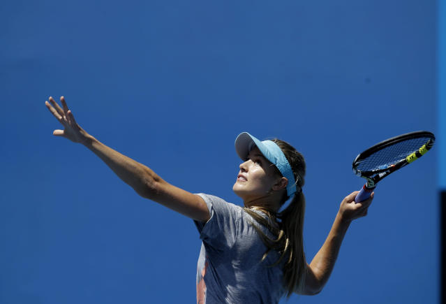 Eugenie Bouchard of Canada practices serving during a training session at the Australian Open tennis championship in Melbourne, Australia, Wednesday, Jan. 22, 2014. Bouchard faces Li Na of China in the women's singles semifinal Thursday. (AP Photo/Aijaz Rahi)