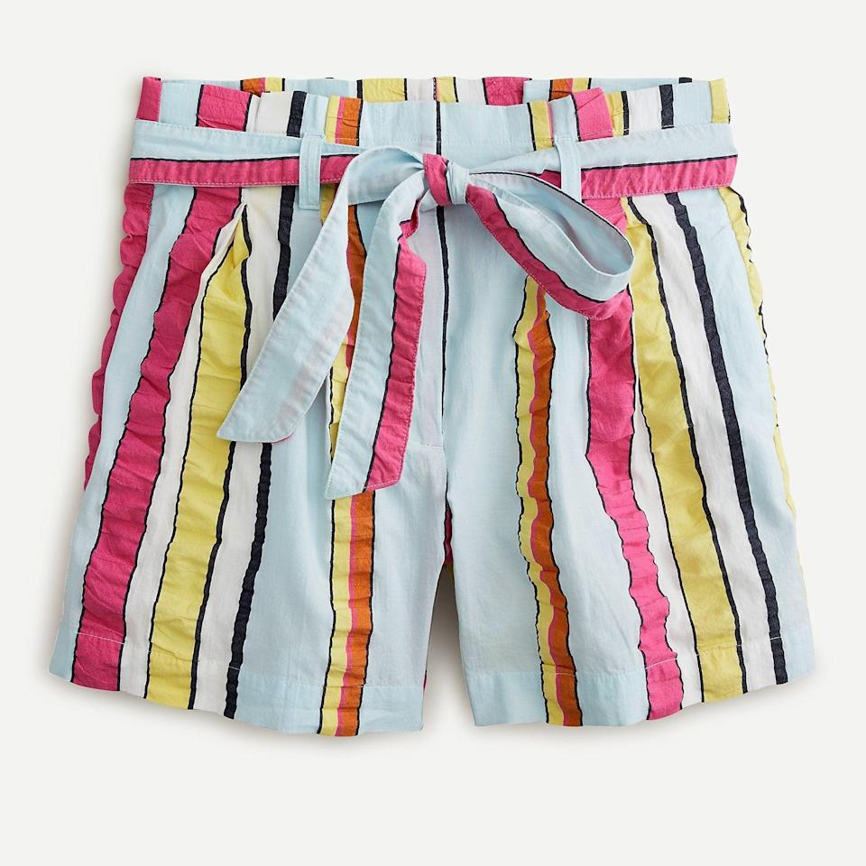 """<p>I'll pair these <a href=""""https://www.popsugar.com/buy/JCrew-Paper-Bag-Shorts-Seersucker-Ribbons-588096?p_name=J.Crew%20Paper-Bag%20Shorts%20in%20Seersucker%20Ribbons&retailer=jcrew.com&pid=588096&price=60&evar1=fab%3Aus&evar9=47606849&evar98=https%3A%2F%2Fwww.popsugar.com%2Ffashion%2Fphoto-gallery%2F47606849%2Fimage%2F47606967%2FJCrew-Paper-Bag-Shorts-in-Seersucker-Ribbons&list1=shopping%2Ceditors%20pick%2Csummer%20fashion%2Cfashion%20shopping&prop13=mobile&pdata=1"""" class=""""link rapid-noclick-resp"""" rel=""""nofollow noopener"""" target=""""_blank"""" data-ylk=""""slk:J.Crew Paper-Bag Shorts in Seersucker Ribbons"""">J.Crew Paper-Bag Shorts in Seersucker Ribbons</a> ($60) with a classic white tee and sneakers. I own a few similar pairs from the brand, and they're quite comfy.</p>"""