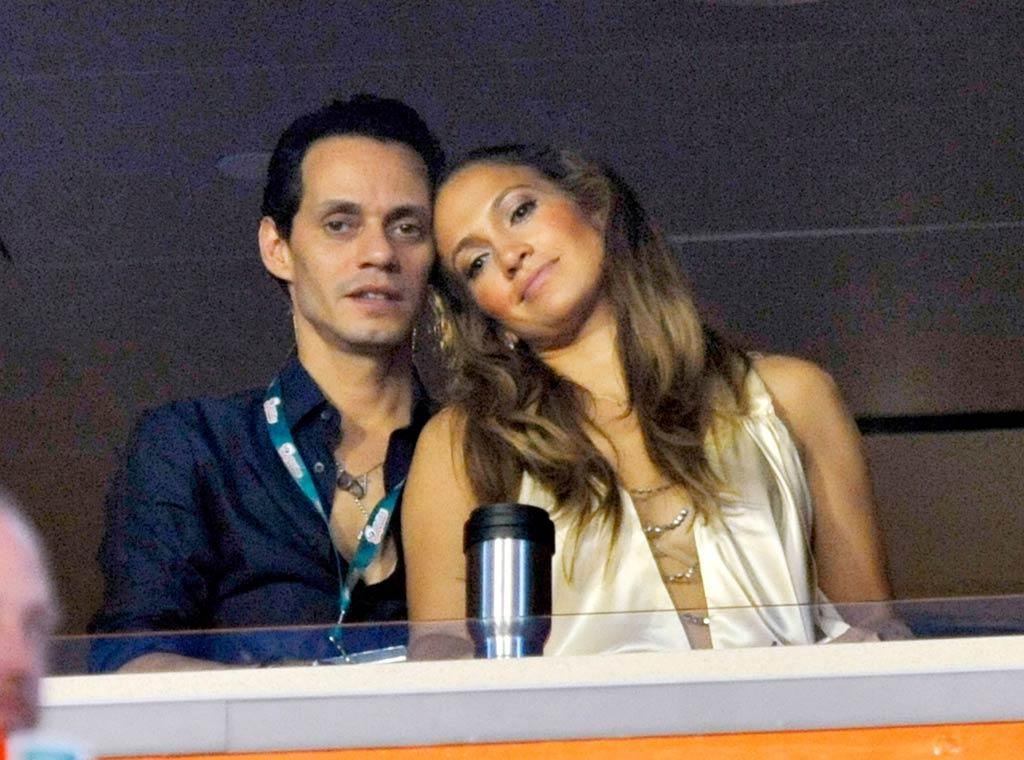 "With his singing duties over, Anthony joined his wife in their reserved seats. Looks like the married couple of six years has kept the romance alive! Kevin Mazur/<a href=""http://www.wireimage.com"" target=""new"">WireImage.com</a> - September 26, 2010"