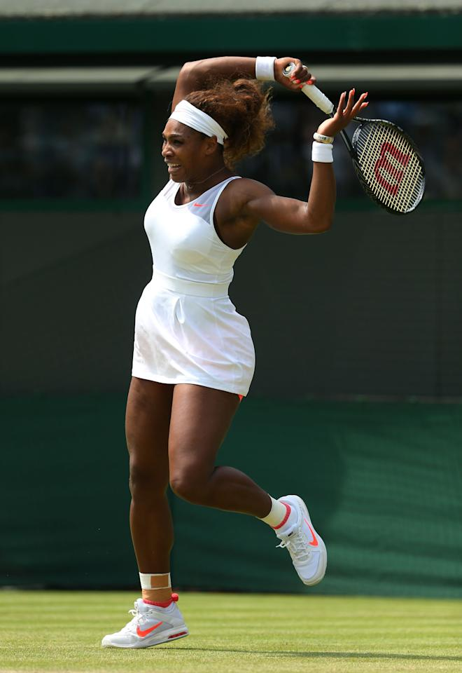 LONDON, ENGLAND - JUNE 27: Serena Williams of the United States of America plays a forehand during the Ladies' Singles second round match against Caroline Garcia of France on day four of the Wimbledon Lawn Tennis Championships at the All England Lawn Tennis and Croquet Club on June 27, 2013 in London, England. (Photo by Julian Finney/Getty Images)