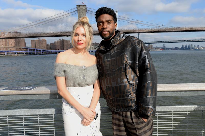"NEW YORK, NEW YORK - NOVEMBER 19: Sienna Miller(L) and Chadwick Boseman poses during a photo call for ""21 Bridges"" at The Fulton on November 19, 2019 in New York City. (Photo by Brad Barket/Getty Images for STXfilms)"