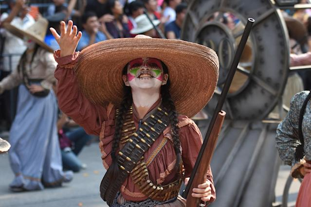 <p>People are seen participate during the traditional Skulls Parade as part of Day of the Dead celebrations at Reforma Avenue on Oct. 28, 2017 in Mexico City, Mexico. (Photo: Carlos Tischler/NurPhoto via Getty Images) </p>