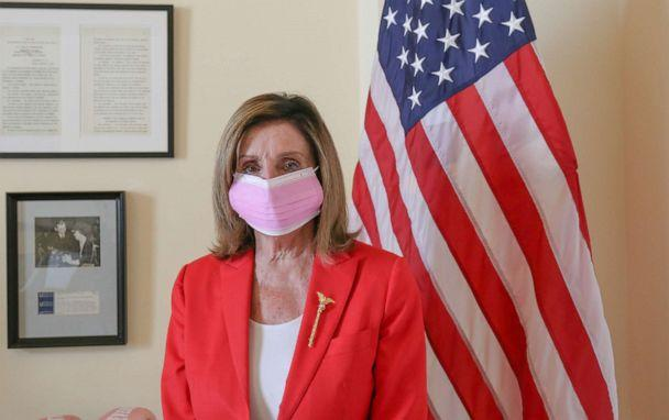 PHOTO: House Speaker Nancy Pelosi poses in a pink mask ahead of a campaign to encourage the use of masks. (Office of the Speaker of the House)