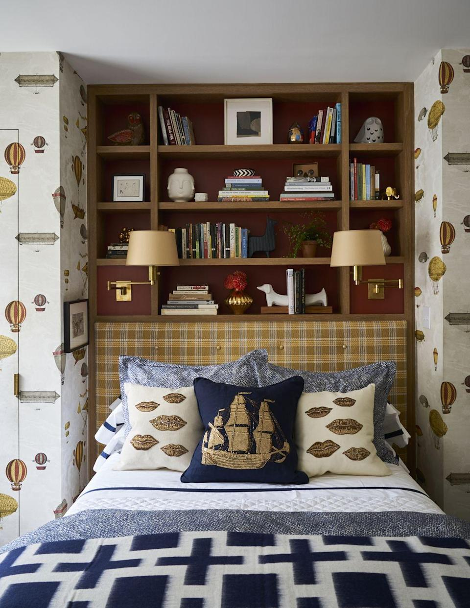 """<p>This bedroom by designer <a href=""""http://www.katielydoninteriors.com/"""" rel=""""nofollow noopener"""" target=""""_blank"""" data-ylk=""""slk:Katie Lyndon"""" class=""""link rapid-noclick-resp"""">Katie Lyndon</a> is the perfect example of how to decorate a space that can grow with a person. It has smart storage solutions with playful yet grown-up decor on display, a neutral color palette brought to life with fun prints and motifs, and high-quality bedding. For a similar feel, try mixing bold prints within a tight color scheme and make sure the details are polished—like these traditional sconces. </p>"""
