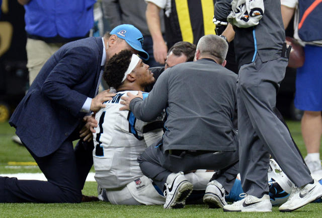 Carolina Panthers quarterback Cam Newton is tended to by medical personnel after being sacked in the second half of an NFL football game against the New Orleans Saints in New Orleans, Sunday, Jan. 7, 2018. (AP Photo/Bill Feig)