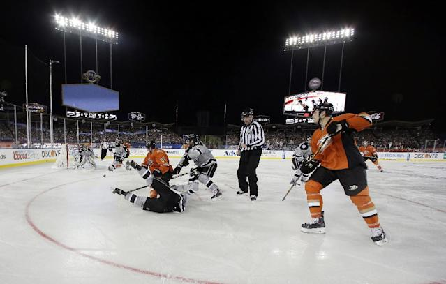 The Los Angeles Kings and the Anaheim Ducks compete during the first period of an NHL outdoor hockey game at Dodger Stadium in Los Angeles, Saturday, Jan. 25, 2014. (AP Photo/Chris Carlson)