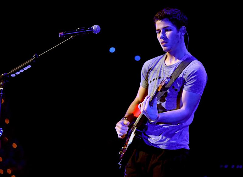 LOS ANGELES, CA - DECEMBER 01: Musician Nick Jonas of the Jonas Brothers performs onstage during KIIS FM's 2012 Jingle Ball at Nokia Theatre L.A. Live on December 1, 2012 in Los Angeles, California. (Photo by Christopher Polk/Getty Images for Clear Channel)