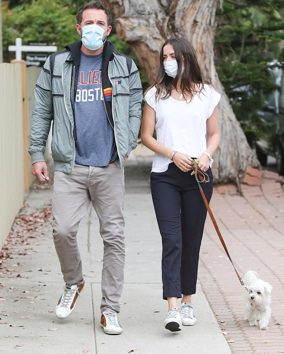 <p>Ben Affleck and Ana de Armas enjoy a stroll with her pup in Los Angeles on Friday. </p>