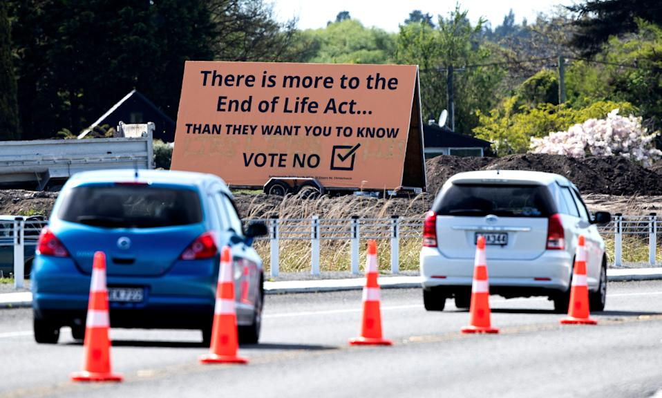 """In this Oct. 16, 2020, file photo, cars are driven past a billboard urging voters to vote """"No"""" against euthanasia in Christchurch, New Zealand. New Zealanders have voted on Friday, Oct. 30, 2020 in favor of legalizing euthanasia in a binding referendum."""