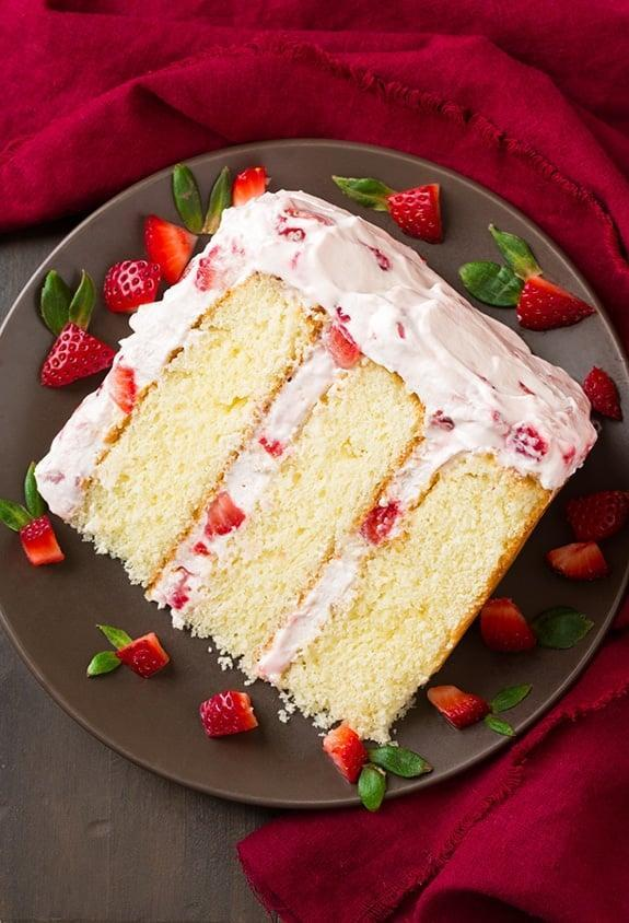 "<p>A timeless staple, strawberry cake is a tried-and-true classic. This recipe will introduce you to a fluffy vanilla cake that's stuffed with fresh strawberries and topped with a rich cream cheese whipped cream. Let's just say that if you make this, Valentine's Day will be complete.</p> <p><strong>Get the recipe</strong>: <a href=""https://www.cookingclassy.com/fresh-strawberry-cake/"" class=""link rapid-noclick-resp"" rel=""nofollow noopener"" target=""_blank"" data-ylk=""slk:fresh strawberry cake"">fresh strawberry cake</a></p>"