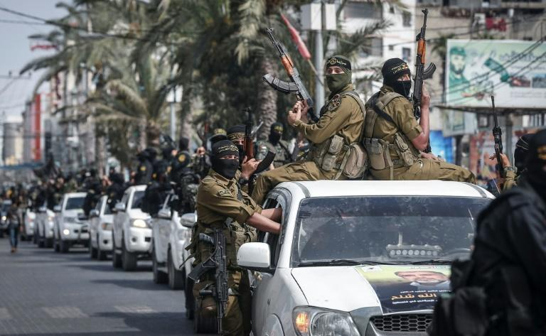 Members of the Palestinian Islamic Jihad militant group take part in a symbolic funeral for the movement's former leader Ramadan Shalah in Gaza city on June 7 (AFP Photo/MAHMUD HAMS)