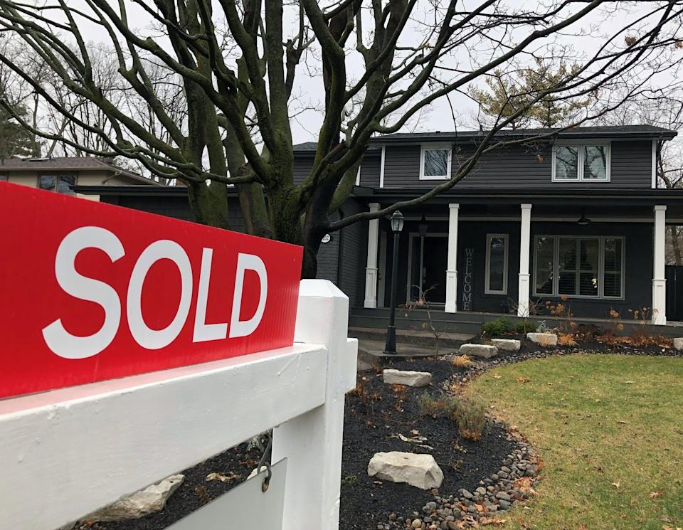 """<span class=""""caption"""">A real estate sold sign is shown in Oakville, Ont., in December 2020. Real estate and farmland are traditional hedges against inflation.</span> <span class=""""attribution""""><span class=""""source"""">THE CANADIAN PRESS/Richard Buchan</span></span>"""