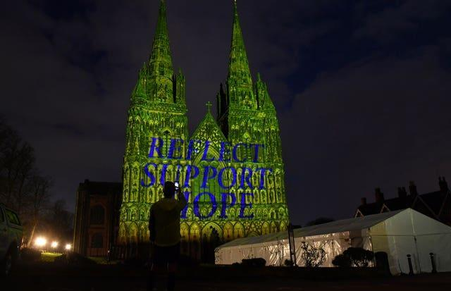 Lichfield Cathedral in Staffordshire is illuminated with the words Reflect, Support, Hope during the National Day of Reflection