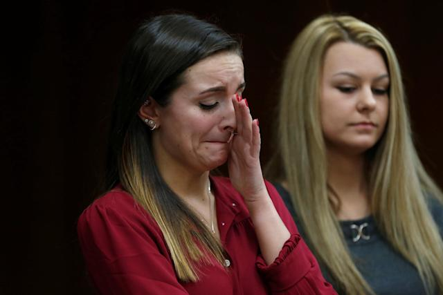 Kaitlyn Basel (L) gives a victim impact statement during the sentencing hearing of Larry Nassar, a former team USA Gymnastics doctor who pleaded guilty in November 2017 to sexual assault charges, in the Eaton County Court in Charlotte, Michigan, U.S., February 2, 2018. REUTERS/Rebecca Cook