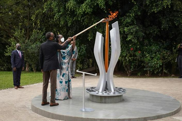 Rwandan President Paul Kagame and his wife Jeannette light a remembrance flame for victims of the genocide