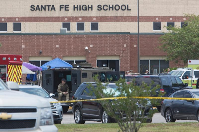 Emergency crews gather in the parking lot of Santa Fe High School, where at least eight people were killed by a heavily armed student (AFP Photo/Daniel KRAMER)