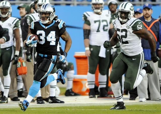 Carolina Panthers' DeAngelo Williams (34) runs past New York Jets' David Harris (52) for a touchdown during the first half of an NFL football game in Charlotte, N.C., Sunday, Dec. 15, 2013. (AP Photo/Mike McCarn)